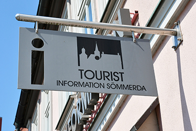 Ausleger Tourist-Information am Haus
